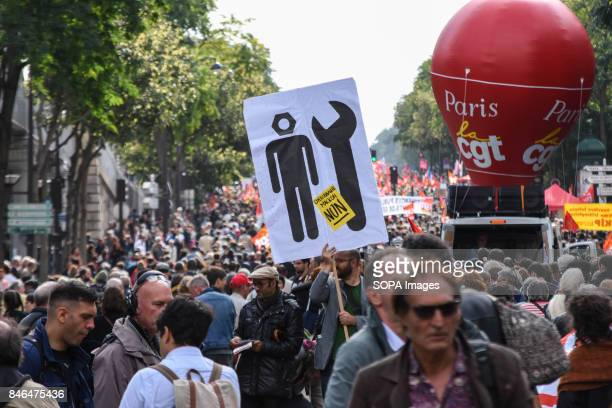 Activists holds banners and shout slogans as they take part in a protest during the nationwide strike called by various French unions against...