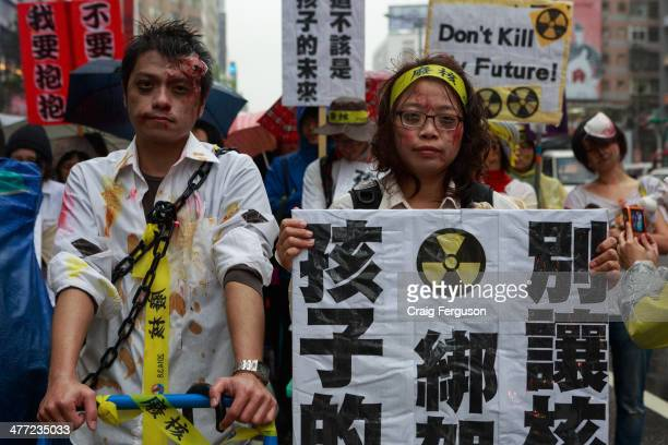Activists in elaborate costumes join a demonstration against nuclear power