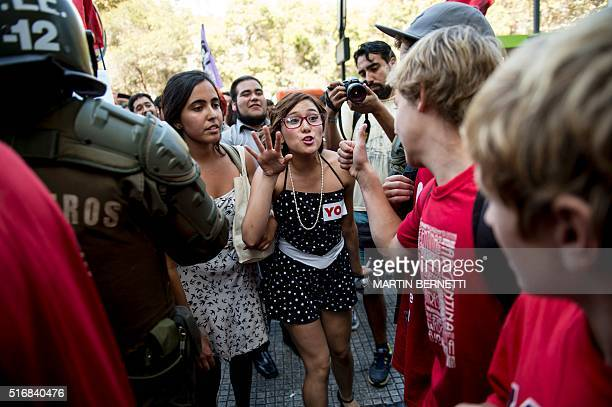 Activists in favor of abortion argue with others who are against during demos in Santiago on March 21 2016 Lawmakers in Chile's lower house of...