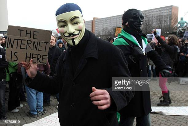 Activists in Guy Fawkes masks dance during a demonstration against the AntiCounterfeiting Trade Agreement on February 25 2012 in Berlin Germany ACTA...