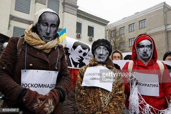 Activists in masks depicting Russian President Vladimir Putin take a part at protest of Ukrainian journalists demanding the release of Ukrainian...
