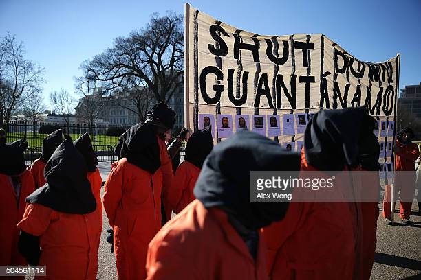 Activists in orange jump suit participate in a rally in front of the White House to demand the closure of Guantanamo Bay detention camp January 11...