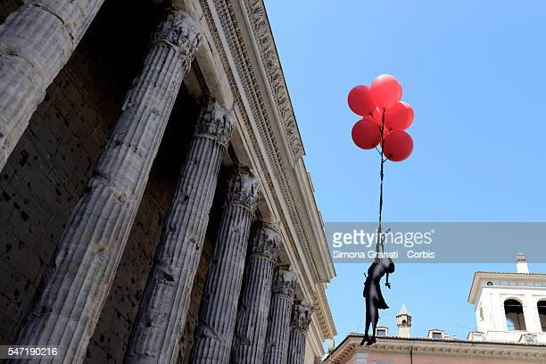 Activists in solidarity with the Palestinian people in Piazza Di Pietra going at the exibition of Banksy at Palazzo Cipolla reproducing the famous...