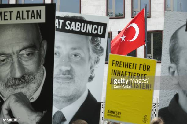 Activists including supporters of Reporters Without Borders and Amnesty International hold up the photos of journalists who are currently in prison...