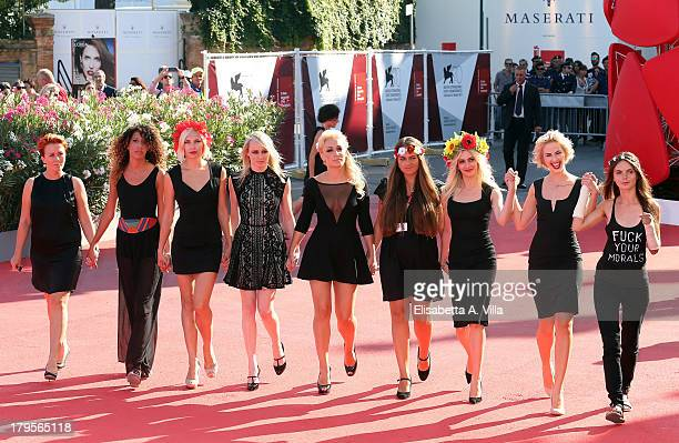FEMEN activists Inna Shevchenko and Sasha Shevchenko arrive on the red carpet before the 'Sacro GRA' Premiere during the 70th Venice International...