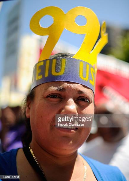 Activists labor unions and Occupy LA protestors critical of corporate tax rates hold a rally in the Bank of America Plaza before the start of their...