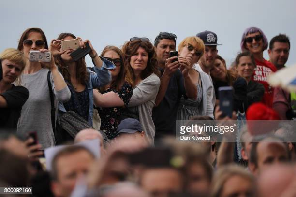 Activists listen to Labour Leader Jeremy Corbyn outside the conference centre after addressing delegates at the Unison Conference on June 23 2017 in...