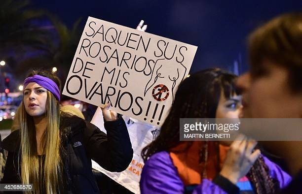 Activists march during a proabortion protest in Santiago on July 25 2014 Thousands of people gathered in Santiago Friday to demonstrate they support...