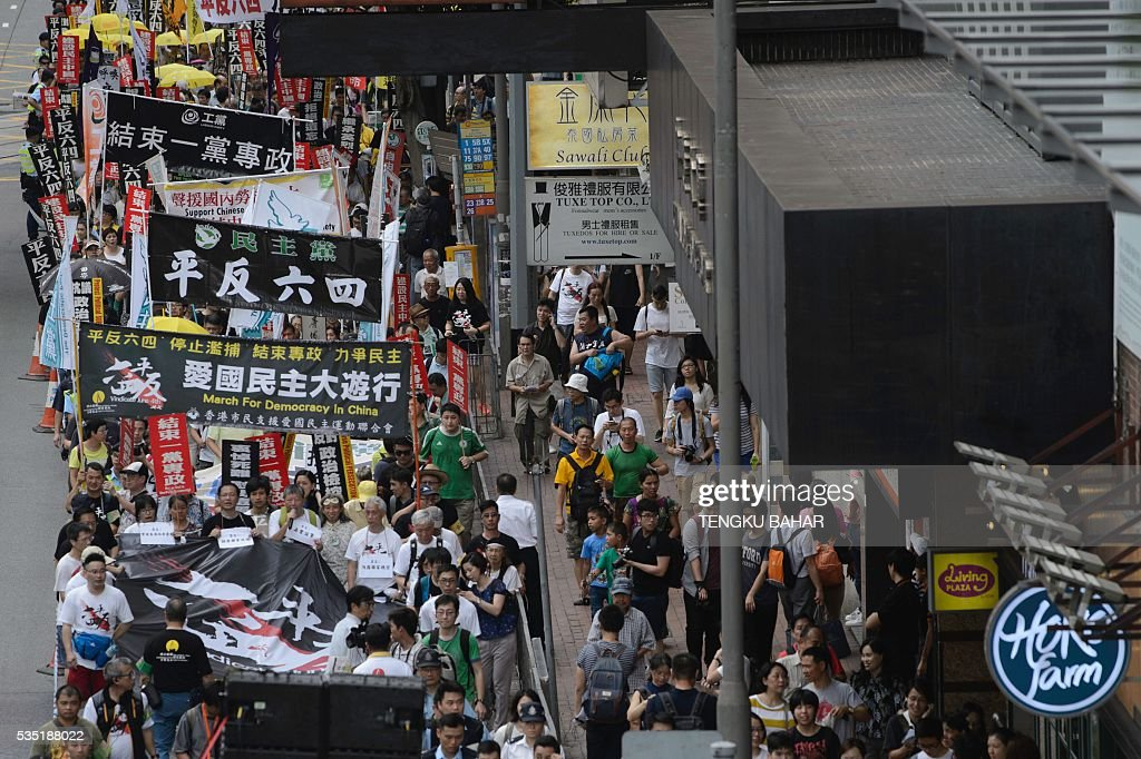 Activists march during a pro-democracy rally ahead of the anniversary of the June 4, 1989 Tiananmen Square crackdown, in Hong Kong on May 29, 2016. People will gather in Hong Kong on June 4 for the annual remembrance ceremony to mark the 27th anniversary of the Tiananmen Square crackdown. / AFP / TENGKU