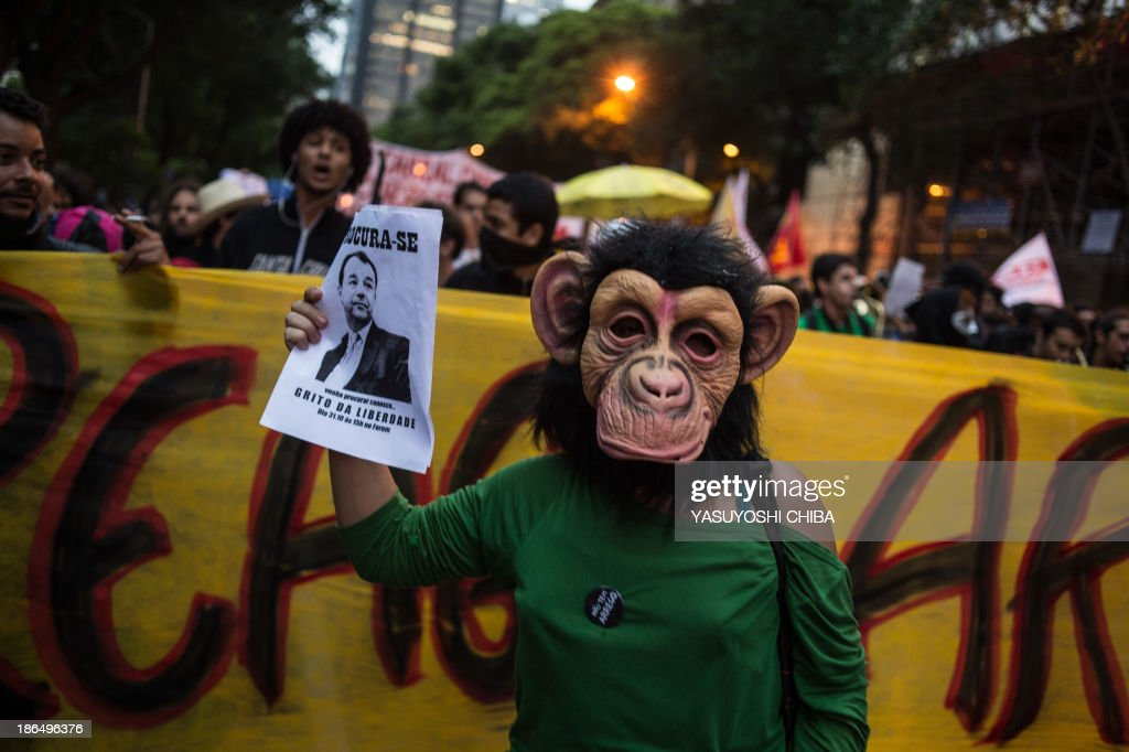 Activists march during a silent demonstration against police violence against protestors, political corruption and demanding better public services in Rio de Janeiro, Brazil, on October 31, 2013.