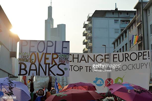 Activists march in a demonstration organized by the Blockupy movement to protest against the policies of the European Central Bank after the ECB...