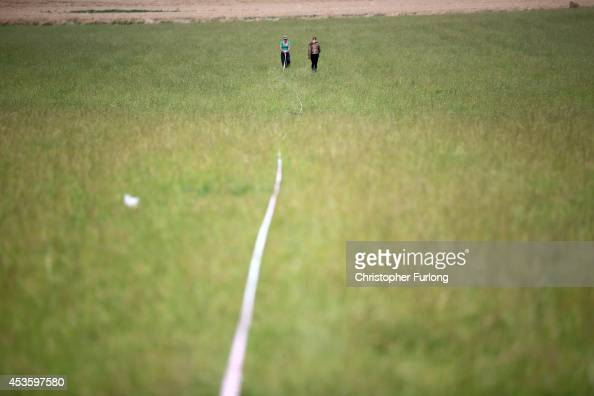 Activists mark out the field of a camp site in prepration for the arrival of other activists at an antifracking camp near the site of a proposed...