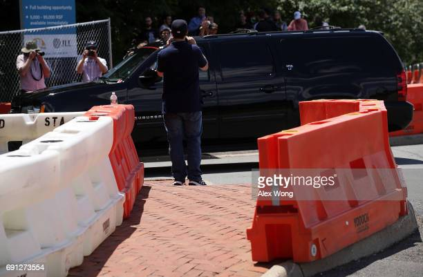 Activists monitor incoming traffic at the entrance of Westfield Marriott Hotel where the Bilderberg Meeting takes place June 1 2017 in Chantilly...