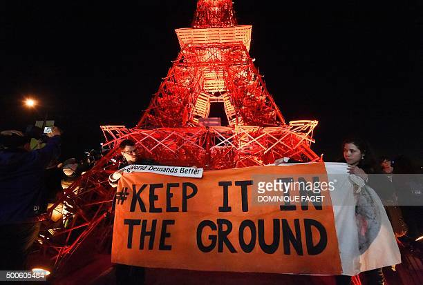 Activists of a nongovernmental organization protest with a banner reading 'Keep it in the ground' during the UN conference on climate change COP21 in...
