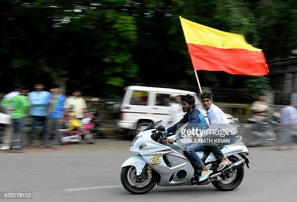 Activists of a proKannada organisation carry the Karnataka flag on their motorcycle during a protest rally in Bangalore on April 18 2015 Various...