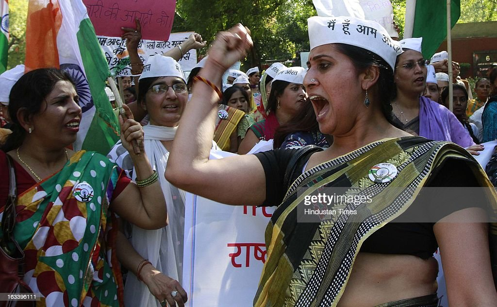 Activists of Aam Adami Party (AAP) shout slogans participates in a rally demands for tough new rape laws, better police protection for women and a sustained campaign to change society's on International Women's Day to raise their voice against it on International Women's Day on March 8, 2013 in New Delhi, India.