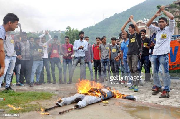 Activists of ABVP burning effigy of Chief Minister Virbhadra Singh during protest against against the Kothai Gangrape case at Mandi college on July...