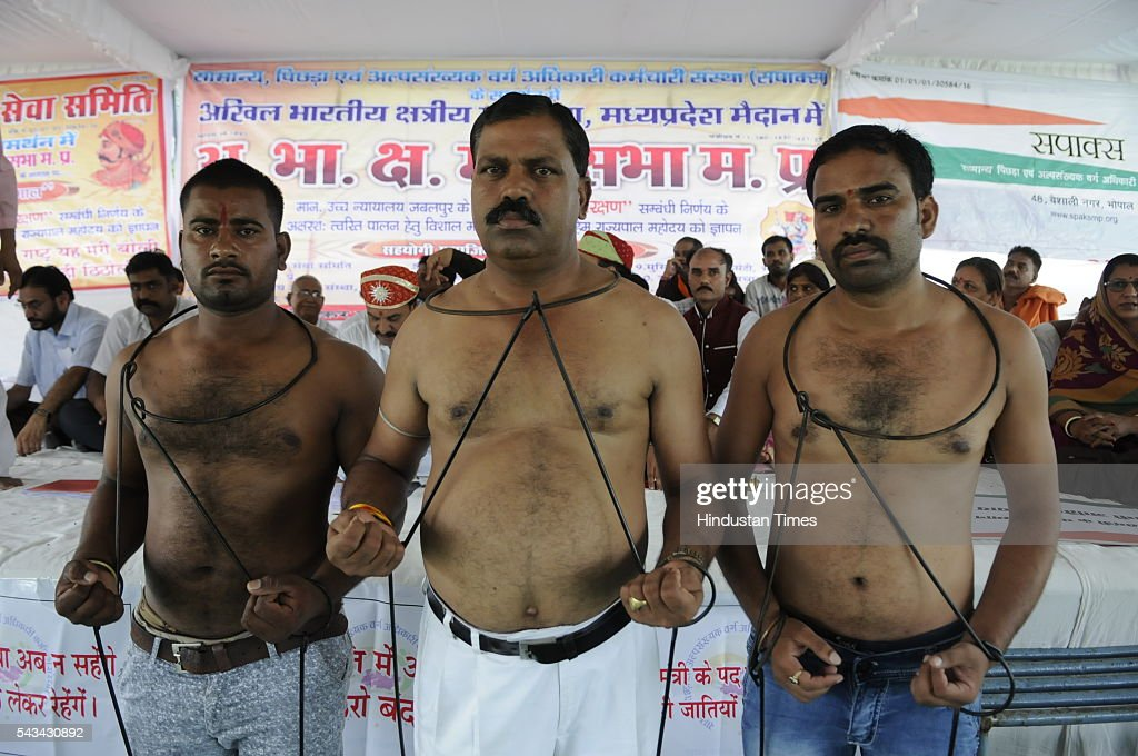 Activists of Akhil Bhartiya Kshatriya Mahasabha staging shirtless protest in support of Samanya Pichhda evam Alpsankhyak Adhikari Karmchari Sangh, against the reservation in promotions in Government Services on June 28, 2016 in Bhopal, India.