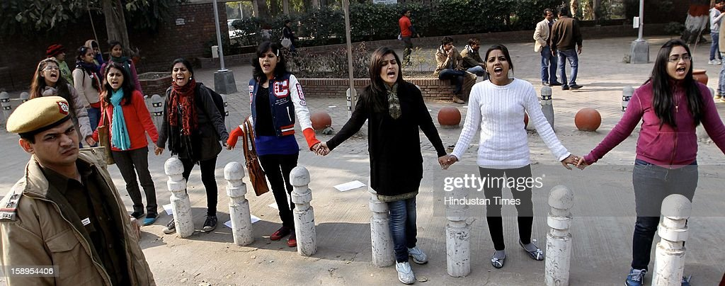 Activists of Akhil Bhartiya Vidyarthi Parishad (ABVP) formed a human chain demanding justice to the 23 yr old girl who succmbed to the injuries after gangrape, at Delhi University Arts Faculty on January 4, 2013 in New Delhi, India.