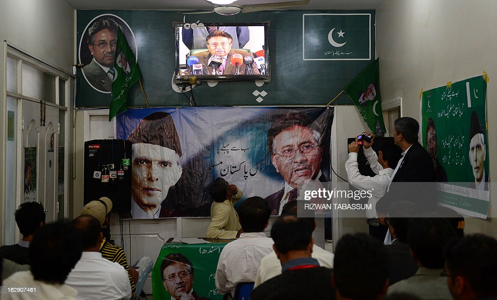 Activists of All Pakistan Muslim League (APML) watch the press conference of their leader, former Pakistan President Pervez Musharraf on television at the APML office in Karachi on March 1, 2013. Musharraf said Friday he would return home within weeks to contest elections after nearly five years in self-imposed exile, but did not set a specific date. AFP PHOTO/Rizwan TABASSUM
