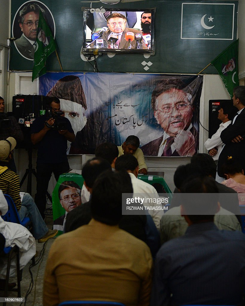 Activists of All Pakistan Muslim League (APML) watch the press conference of their leader ex-Pakistan President Pervez Musharraf on television at the APML office in Karachi on March 1, 2013. Musharraf said Friday he would return home within weeks to contest elections after nearly five years in self-imposed exile, but did not set a specific date. AFP PHOTO/Rizwan TABASSUM