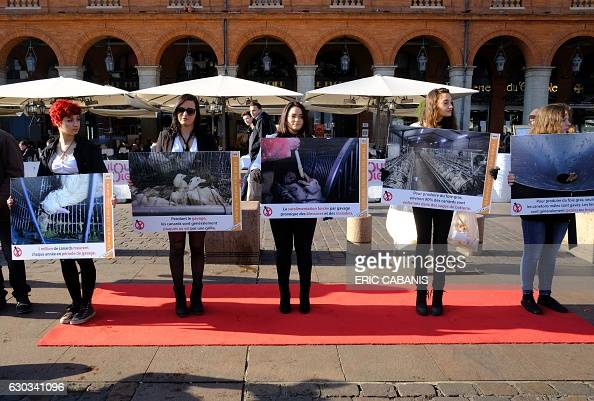 Activists of animal rights association L214 hold banners during a gathering to ask for the suppression of the forcefeeding of ducks and Foie gras on...