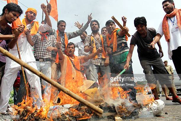 Activists of Bajrang Dal Bharatiya Janta Party burning effigies tyres and raising slogans against the state Government after Kishtwar incident on...
