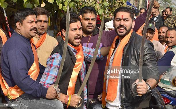 Activists of Bajrang Dal with Vishva Hindu Parishad raise religious slogans during a procession marking the 24th anniversary of the demolition of the...