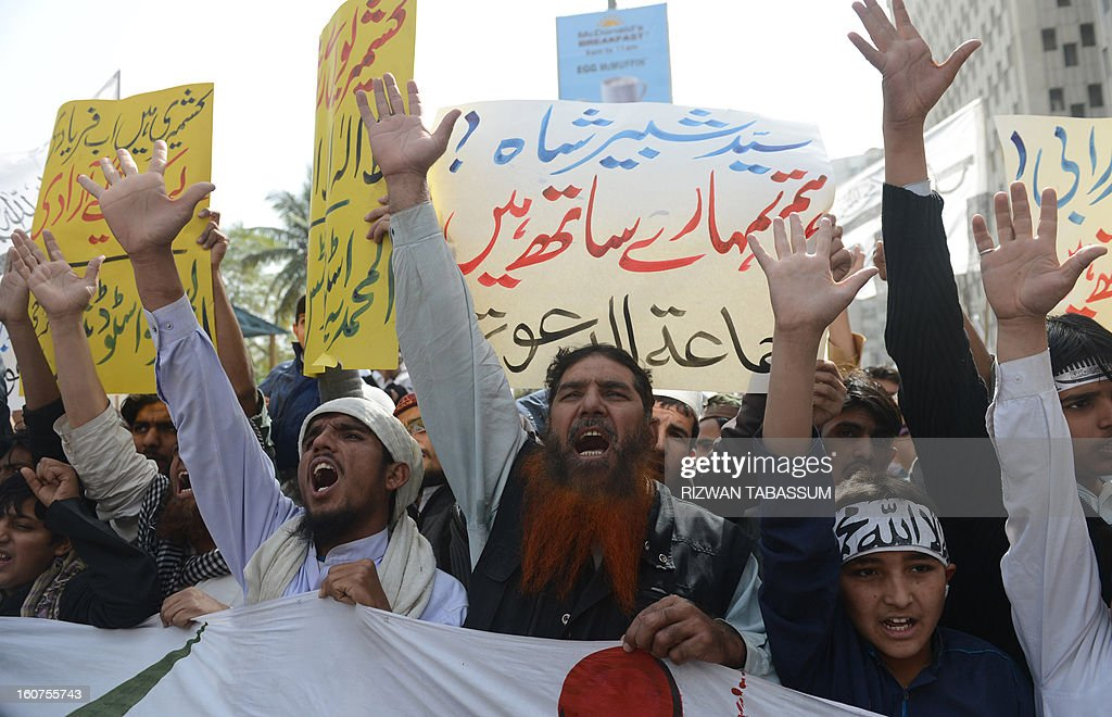 Activists of banned charity Jamaat-ud-Dawa shout slogans to mark Kashmir Solidarity Day in Karachi on February 5, 2013. Pakistan observed Kashmir Solidarity Day on February 5, to denounce Indian rule in the disputed Himalayan region claimed in whole by both countries. AFP PHOTO/Rizwan TABASSUM