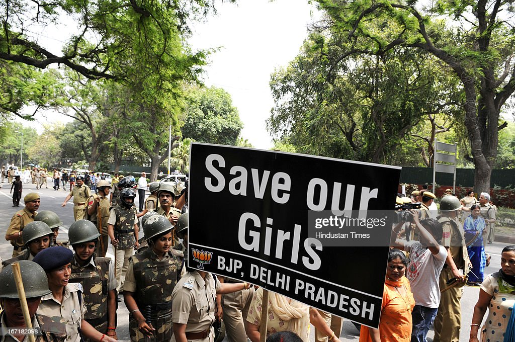 Activists of Bharatiya Janata Party shouts anti Government slogans outside the UPA Chairperson Sonia Gandhi's residence during a demonstration against the rape of a five-year old girl on April 21, 2013 in New Delhi, India. A five year girl went missing on April 15 and was found on April 17 in same building where she lives with her parents. She was found in serious condition after being brutally raped and tortured with slashed neck and bite marks on her body. The man who lives in that room was arrested in Bihar state on April 20.