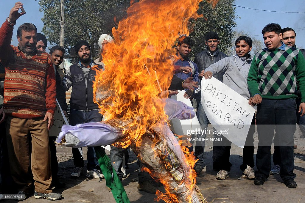 Activists of Bharatiya Janata Yuva Morcha (BJYM) burn an effigy of the Pakistani government during a protest against the death of of Indian soldiers Lance Naik Hemraj and Sudhakar Singh in Amritsar on January 10, 2013. India summoned Pakistan's envoy in New Delhi Wednesday to protest the killing of two soldiers in a border clash, but warned against any escalation, after apparent tit-for-tat skirmishes that have led to deaths on both sides. Two Indian soldiers died after a firefight erupted in disputed Kashmir on Tuesday as a patrol moving in fog discovered Pakistani troops about 500 metres (yards) inside Indian territory, according to the Indian army. AFP PHOTO/NARINDER NANU
