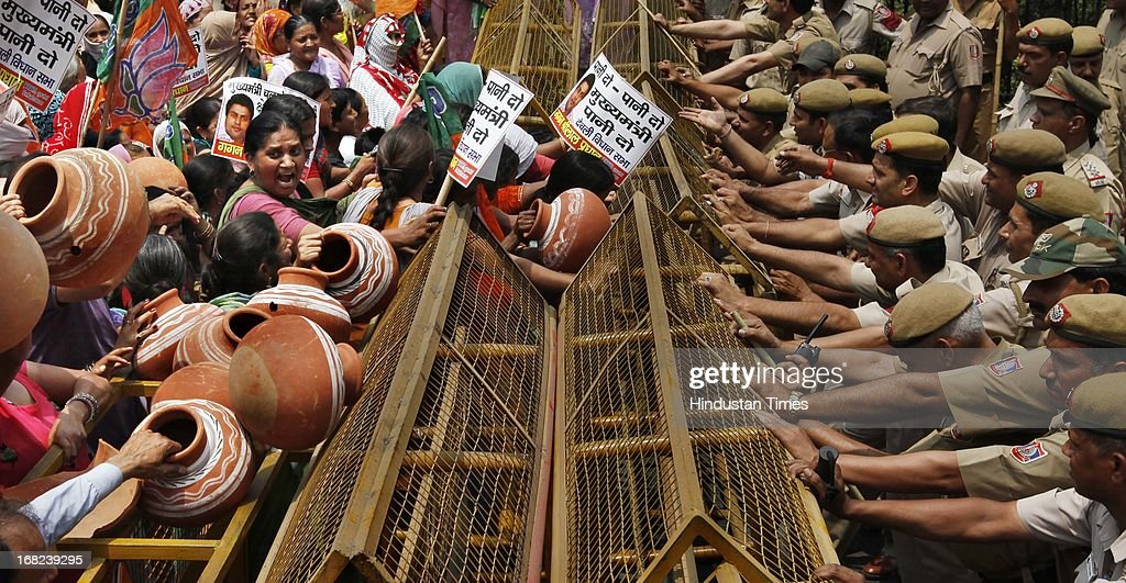 Activists of Bhartiya Janata Party carry earthen pots as they shout anti-Delhi Congress government slogans during a protest over the shortage of water in the capital on May 7, 2013 in New Delhi, India.