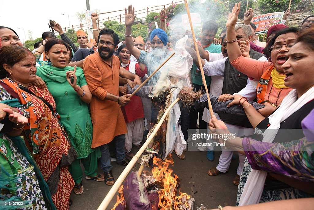 Activists of BJP Mahila Morcha burning effigy of Delhi Deputy chief Minister Manish Sisodia outside his office at East Vinod Nagar during protest against Aam Adami Party Government on June 28, 2016 in New Delhi, India.