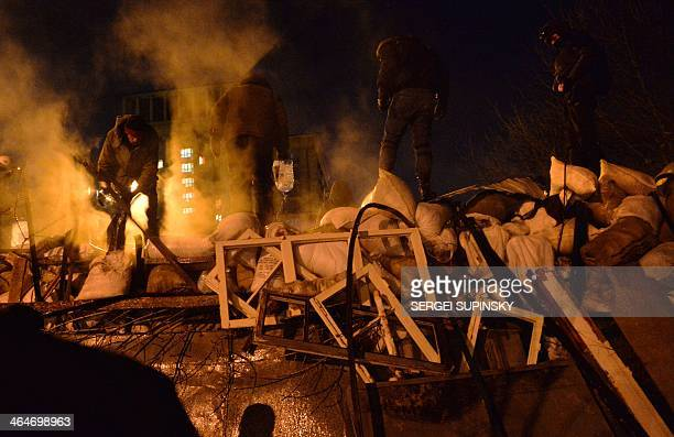 Activists of Euromaidan build a new barricade in the center of the Kiev night on January 24 2014 Crunch talks between the opposition and President...