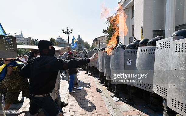 Activists of few radical Ukrainian parties clash with police officers in front og the parliament in Kiev on August 31 2015 At least 20 were wounded...