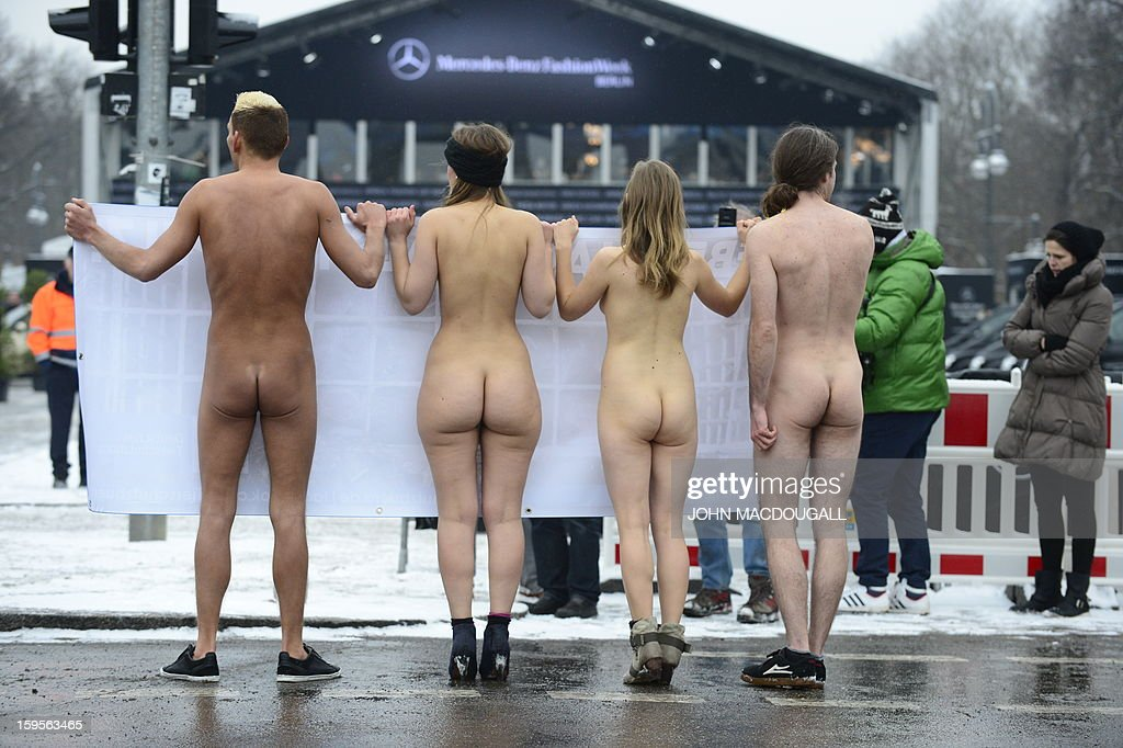Activists of German animal protection organisation 'Deutsches Tierschutzbuero' (German office for animal protection) hold a banner in front of the catwalk hall of the Berlin Fashion week, on January 16, 2013. The activists protests against the presentation of real fur during the Berlin Fashion Week that takes place from January 15 to 20, 2013. AFP PHOTO / JOHN MACDOUGALL