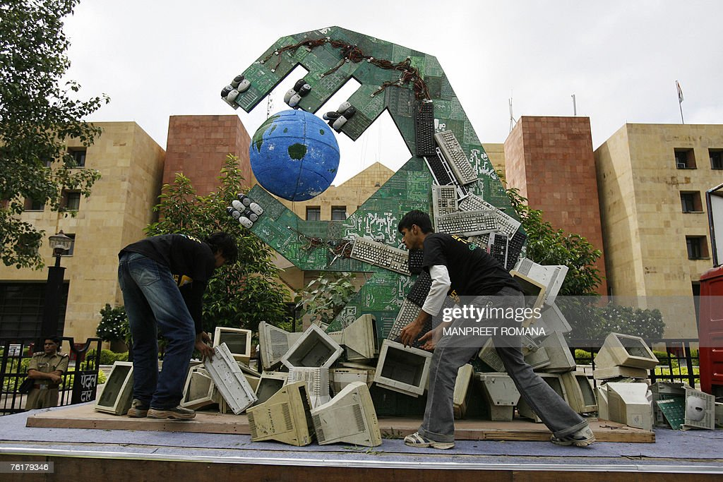 Activists of Greenpeace arrange ewaste on a truck carrying an installation made from hazardous ewaste a reminder of the enormity of the ewaste...