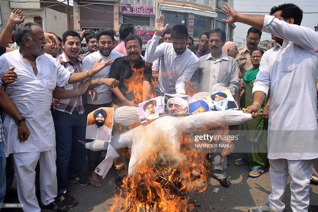 Activists of Hindu Sangharsh Sena shout slogans as they burn an effigy of Punjab state chief minister <a gi-track='captionPersonalityLinkClicked' href=/galleries/search?phrase=Parkash+Singh+Badal&family=editorial&specificpeople=3634862 ng-click='$event.stopPropagation()'>Parkash Singh Badal</a>, Punjab state deputy chief minister Sukhbir Singh Badal, SGPC president Avtar Singh Makkar, Punjab cabinet minister Bikram Singh Majithia, chief minister of Jammu and Kashmir, Mufti Mohammad Sayeed during a demonstration in Amritsar on April 14, 2015. Activists staged a protest against the Punjab government for not giving compensation to the 1984 terrorist victims Hindu families and also protested against the shootout of Shiv Sena state secretary Harvinder Soni while he was playing volleyball at a park in Gurdaspur on April 12. AFP PHOTO / NARINDER NANU