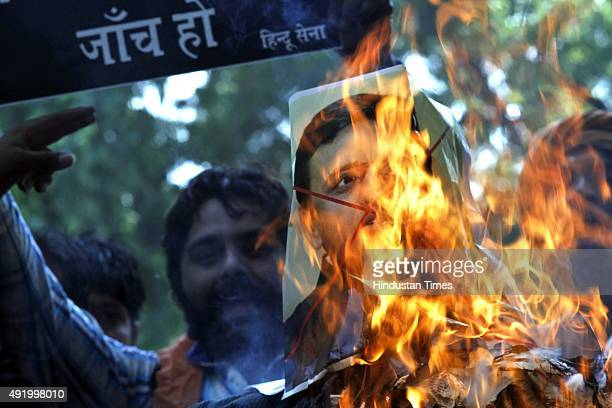 Activists of Hindu Sena or 'Hindu Army' burn an effigy of Chief Minister of Uttar Pradesh Akhilesh Yadav as they demand a Central Bureau of...