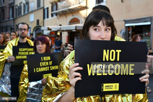 Activists of human rights organization Amnesty International gather in front of the Pantheon to stage a flashmob on World Refugee Day in central Rome...