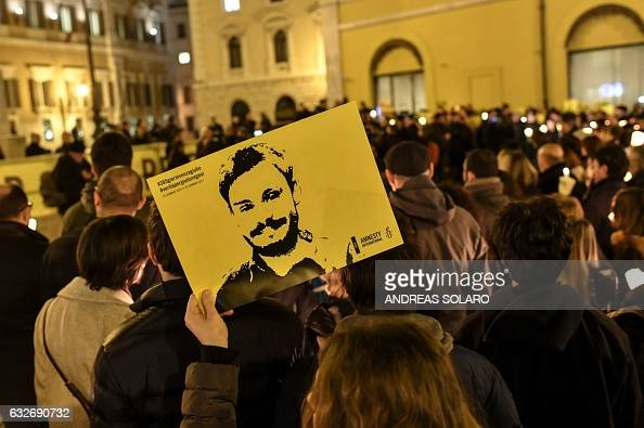 Activists of human rights organization Amnesty International hold a picture of Giulio Regeni and candles as they take part in a demonstration in...
