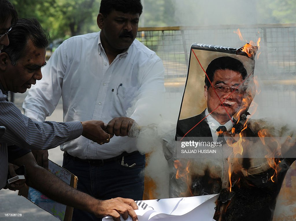 Activists of India's National Panthers Party burn an effigy of former Chinese president Hu Jintao during a protest in New Delhi on April 24, 2013, after an alleged incursion into Indian territory by Chinese troops. India's foreign ministry said that it had asked China to withdraw troops who have allegedly advanced into disputed territory claimed by New Delhi in a remote area of the Himalayas. AFP PHOTO/SAJJAD HUSSAIN