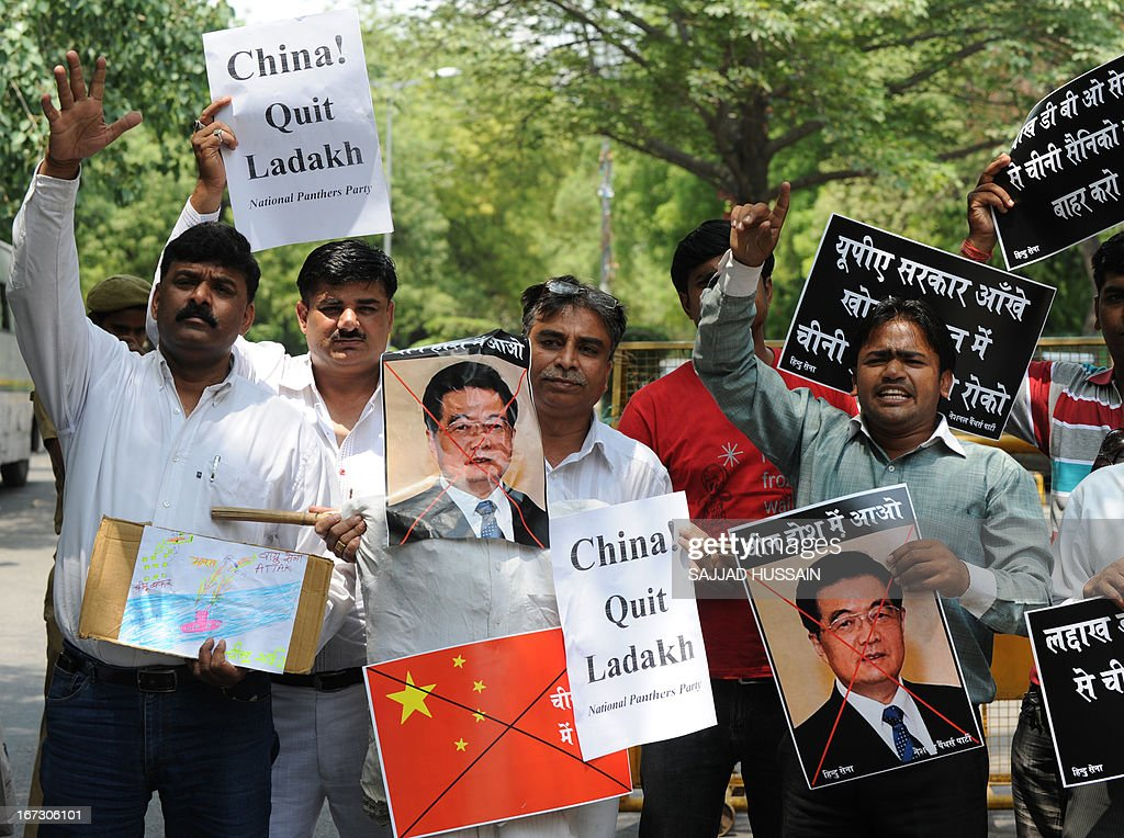 Activists of India's National Panthers Party shout slogans as they hold portraits of former Chinese president Hu Jintao during a protest in New Delhi on April 24, 2013, after an alleged incursion into Indian territory by Chinese troops. India's foreign ministry said that it had asked China to withdraw troops who have allegedly advanced into disputed territory claimed by New Delhi in a remote area of the Himalayas.