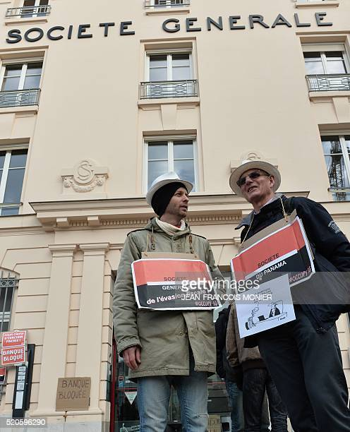 Activists of international movement attac carrying placards reading 'Societe Generale tax evasion' and 'Panama Company' 'I want to transfer my...