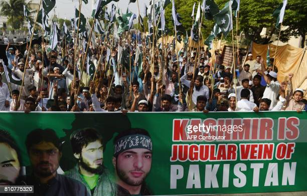 Activists of JamaatudDawa protest at a rally to mark the first anniversary of the death of young rebel leader Burhan Wani who was killed by Indian...