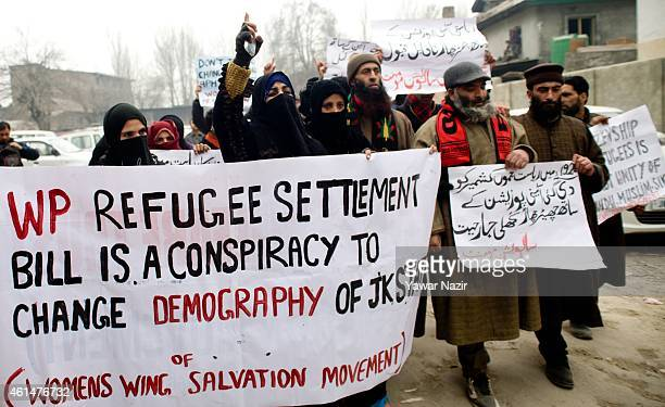 Activists of Jammu and Kashmir Salvation Movement a resistance party hold placards during a protest against India's proposal to allow Pakistani...