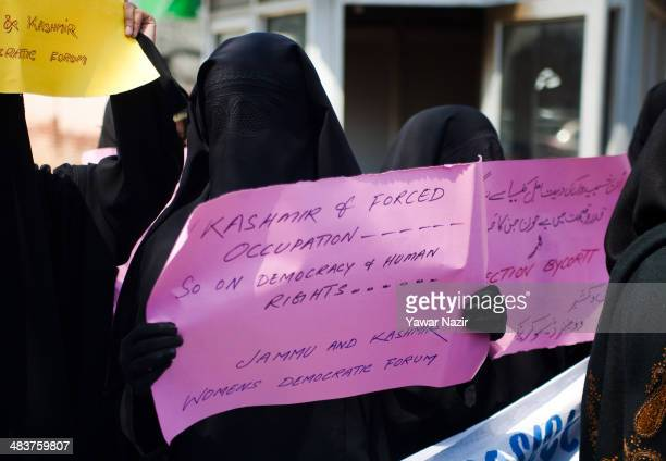 Activists of Jammu Kashmir Women's Democratic Forum hold placards during a protest against the elections held by India in Indianadministered Kashmir...