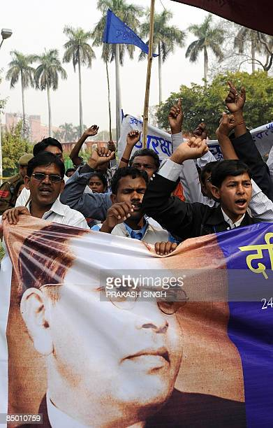 Activists of National Confederation of Dalits Organisations shout slogans for their demands of reservation during a protest march in New Delhi on...
