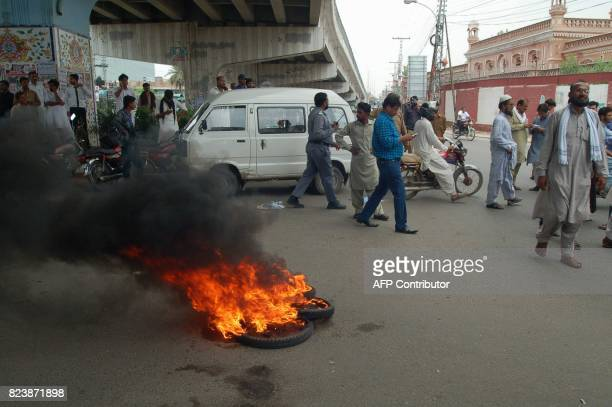 Activists of Pakistan Muslim League Nawaz burn tyres to protest after the Supreme Court decision against Pakistan's Prime Minister Nawaz Sharif in...