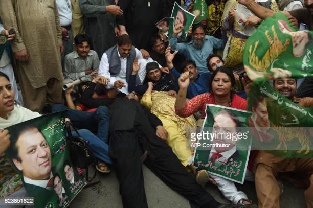 Activists of Pakistan Muslim League Nawaz protest the Supreme Court decision against Prime Minister Nawaz Sharif in Lahore on July 28 2017 Pakistan's...